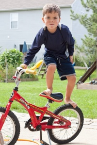 Risky kid on bike